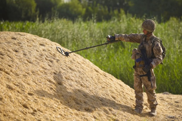 Metal Detector Haystack [U.S. Marine Corps photo by Lance Cpl. James Purschwitz/Released]
